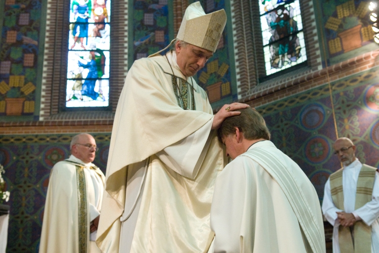 With the laying on of hands, the Old Catholic bishop of Utrecht ordains a deacon as priest. Everything they're wearing has a meaning. (source unknown)