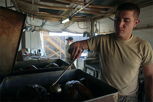 Spc. Seth Breesaw basting Thanksgiving turkeys three years ago for U.S. troops in Afghanistan. Thanksgiving is a national holiday in the United States and a major feast day in The Episcopal Church. (Dario Lopez-Mills/ Associated Press)