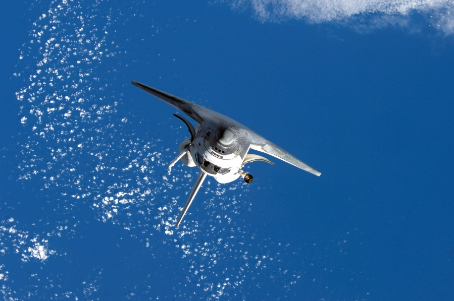 Space shuttle Discovery over the Earth. (National Aeronautics and Space Administration)