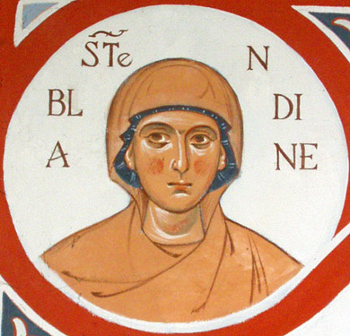 St. Blandina, from the Chapel of the Dormition of the Mother of God, Drome, France. Blandina and other Christians were accused by hysterical mobs of cannibalism, incest and other crimes. Like St. Justin yesterday, Blandina and Companions were martyred during the reign of Marcus Aurelius.