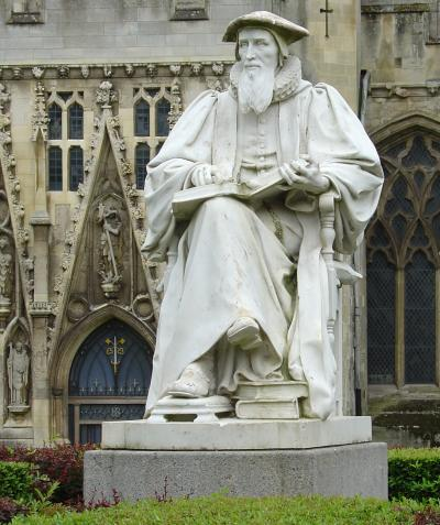"""Richard Hooker statue at Exeter Cathedral, England. He is best known for comparing his theology to a """"three-legged stool"""" of Scripture, Tradition and Reason. Protestants often emphasize the authority of Scripture exclusively, while Romanism has stressed the tradition of """"what the church has taught for a long time."""" But including logic or reason in our understanding of God enables Anglicans to embrace science, ongoing revelation and cultural development in our apprehension of justice and mercy. (Wikipedia)"""
