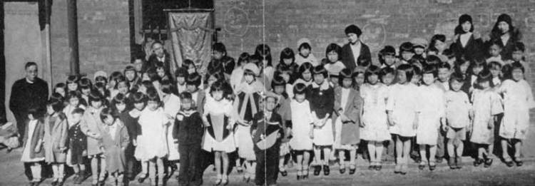Students at Daniel Wu's mission school at True Sunshine Church in San Francisco in the early part of the 20th Century; that's him standing at left. His mentor, Deaconess Emma Drant, started this church as well as one across the bay in Oakland, where many Chinese fled after the Great Earthquake of 1906. When Fr. Wu arrived he took over the administration of both while he was still a seminarian.