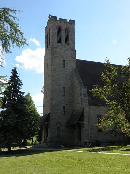"Church of the Holy Apostles, Oneida, Wisconsin, where the People settled after the U.S. government forcibly removed them from New York State. Cornelius Hill was educated at nearby Nashotah House and became a chief while still in his teens. He was a vocal opponent of ""allotment,"" the forced division of tribal lands into private property; after it became law by act of Congress in 1893, he was ordained a deacon at age 61 and, at 69, the first Oneida priest. He and his parishioners built this church, which is still active, and there are shrines to him all over Wisconsin. (Matthew P. Payne)"