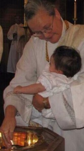 Lani baptizing her granddaughter Abby.