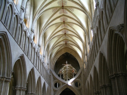 The vaulted ceiling at Wells Cathedral. Note that Gothic Figure 8 at the entrance to the choir. (Wikipedia)