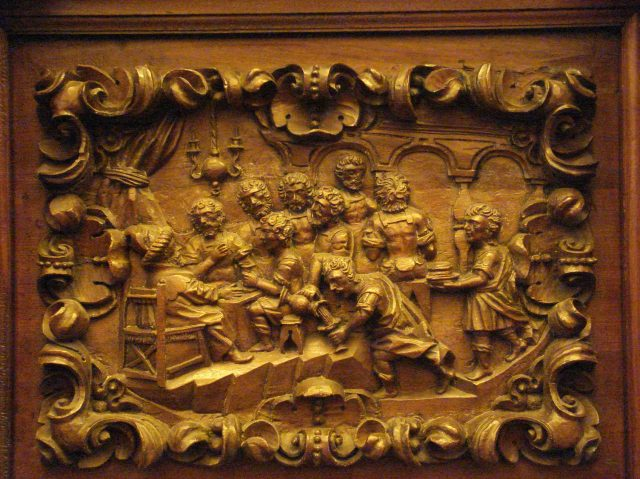 Workshop of Salvador de Campo, 1700-01: Joseph Dines with His Brothers. Carving on choir stalls, Old St. Augustine Church, Mexico City. (Click to enlarge.)
