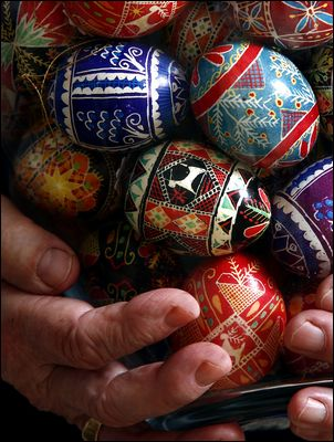 A Ukrainian artist shows some of her painted Easter eggs.