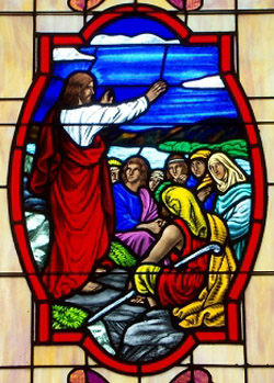 Window depicting Christ's sermon on the mount; source unknown. St. Luke's Gospel includes a series of curses as well as the familiar blessings.