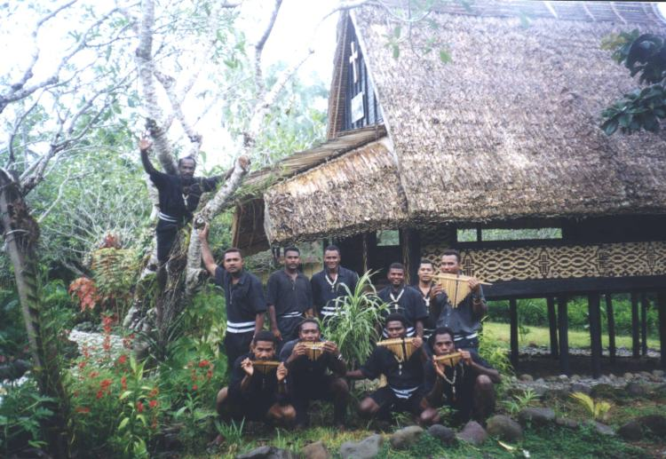 A Melanesian Brothers' chapel, and some of the men with their panpipes. One brother climbed a tree for this photo.