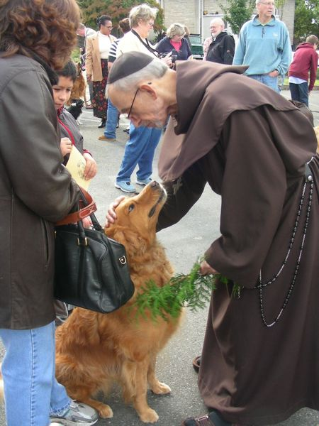 A Franciscan monk blessing the animals on St. Francis' Day 2011, at St. John the Baptist Episcopal Church, Seattle, Washington.