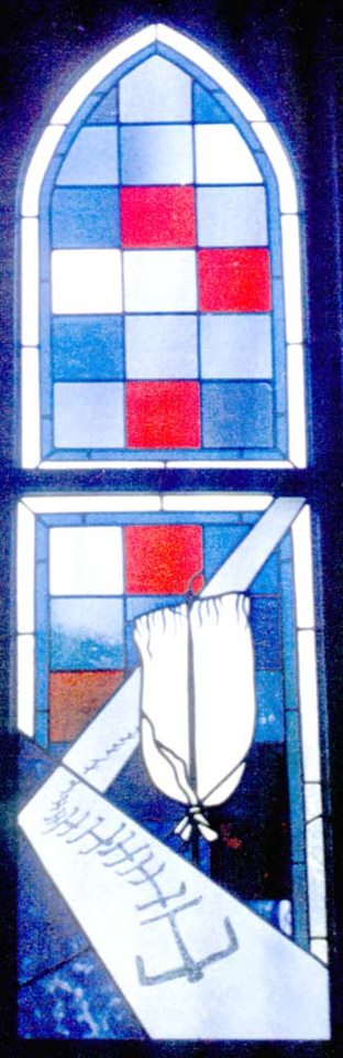 Advent window with native symbols, Christ Church, Kealakekua, Hawai'i: a Lono pole-cross used in processions to celebrate abundant new life, led by marching petroglyphs or rock carvings. Captain Cook arrived at the Big Island on the feast of Lono, in a ship with white sails. (The Rev. Deacon Leilani Nelson)
