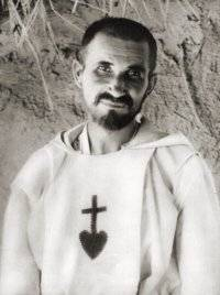 Foucauld lost his faith as a young man until he traveled to Morocco and encountered devout Muslims, which set him on a quest to discover his own spirituality. He joined the Trappists, became a priest with the poor Clares, and moved to the Sahara Desert, where he developed a ministry of presence. He was killed by marauding Bedouins as part of the general uprising against French colonialism in Algeria.