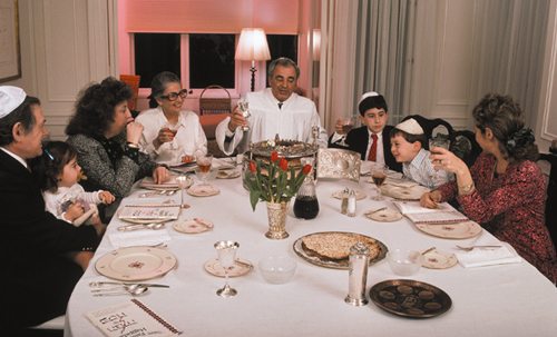 "A modern Passover meal or seder, at which eating and drinking is thoroughly liturgized with a recounting of the story of salvation. at which the question is still asked, ""What makes this night different from all other nights?"""