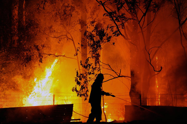 """We have big fires in New South Wales. Australia's going through record hot temperatures – not just a heat wave, but likely global warming. The New York Times reports: """"The average temperature across the country on Tuesday was the highest since statistics began being kept in 1911, at 40° Celsius (104° Fahrenheit), exceeding a mark set only the day before. Meteorologists have had to add two new color bands to their forecast maps, extending their range up to 129° Fahrenheit."""" (Dean Lewins/European Pressphoto Agency)"""