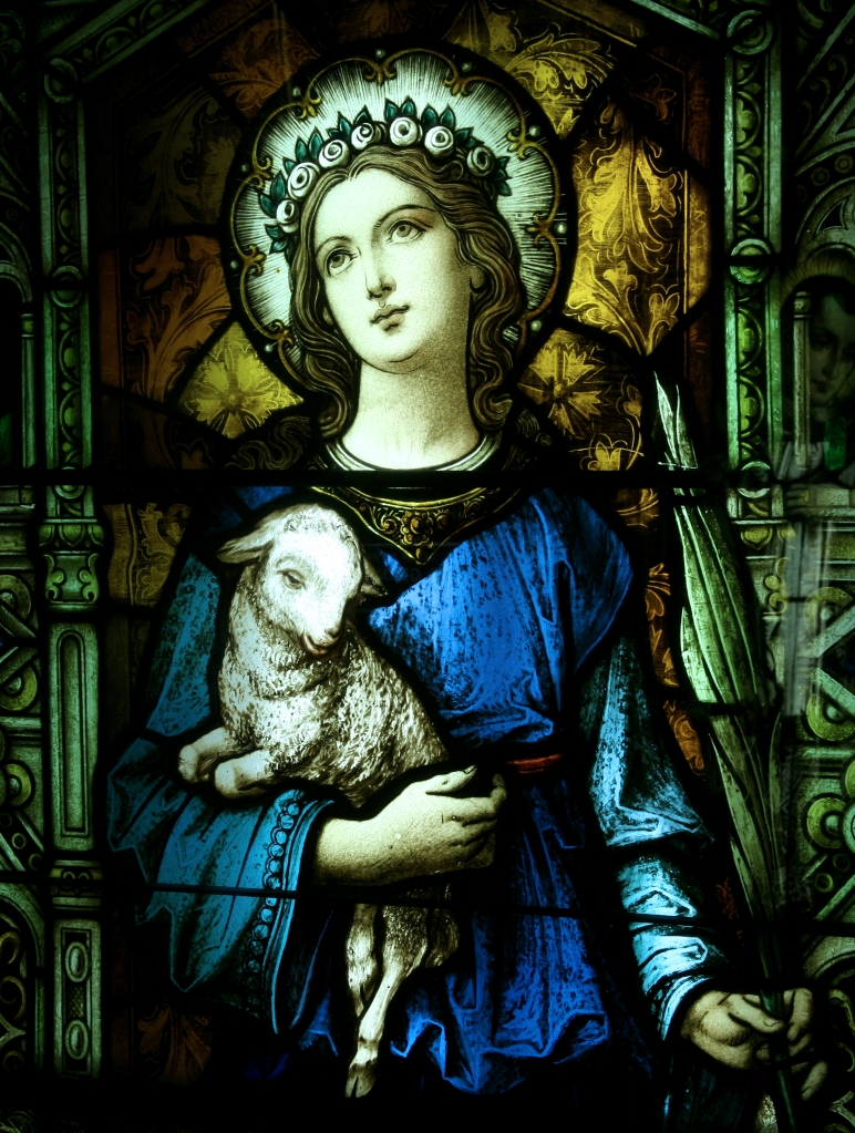 St. Agnes window at St. Ann Roman Catholic Church, West Palm Beach, Florida. As a child of 12 Agnes refused to worship heathen gods, despite enticements and threats, and was martyred as a threat to the emperor, who was a god in the official religion. (S. Smith Photography)