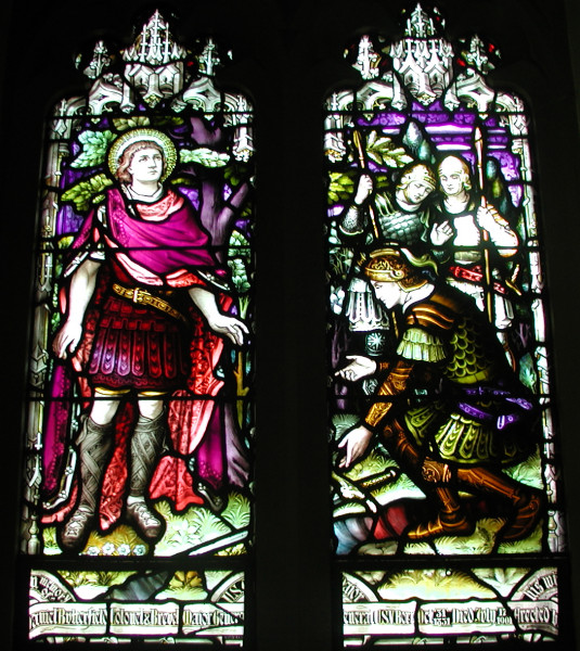 Patronal window, St. Cornelius's, Governors Island, New York City; in the left panel, this army officer hears the call, described in Acts 10; on the right he kneels in worship. It is noteworthy that the collect below identifies Cornelius the centurion, the first Gentile convert, with the unnamed centurion in Matthew and Luke, who met Christ and asked him to heal the slave boy whom he loved. This unnamed officer is quoted in the prayer.