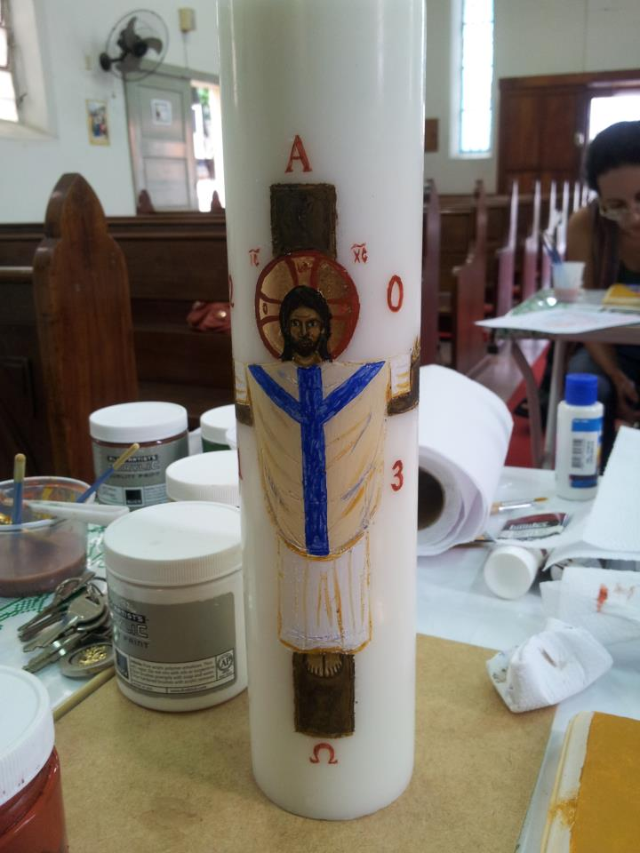 The young Brazilian artist Luiz Coelho, Jr. shows a Paschal candle he's been learning to decorate in iconography class. Liturgical churches burn these elaborate torches during the 50 days of the Easter season.