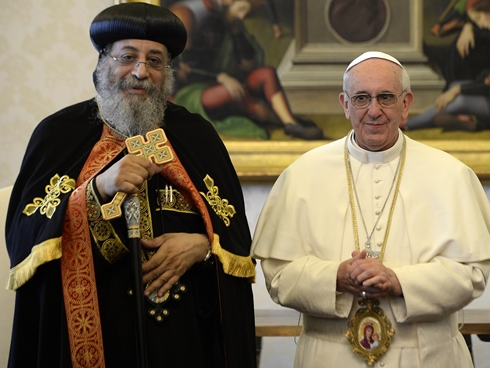 Two new Popes met at the Vatican yesterday, Tawadros II of the Coptic Orthodox Church of Alexandria, Egypt, and Francis of Rome. Churches split after the Council of Chalcedon in 451 over the christological implications of a preposition, an issue widely regarded today as a misunderstanding. Notice that Tawadros carries a Roman cross, while Francis is wearing an Orthodox icon for the visit.  (Andreas Solaro/Associated Press)