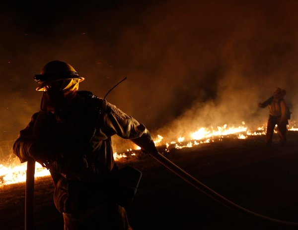 A wildfire has hit Ventura County, including Thousand Oaks, California, and has people worried. The toll by Sunday was 7 injuries, 15 homes damaged, no deaths. Firefighters expect to get the fire under control today, but this is too early for California's usual wildfires. (Patrick T. Fallon/Reuters)
