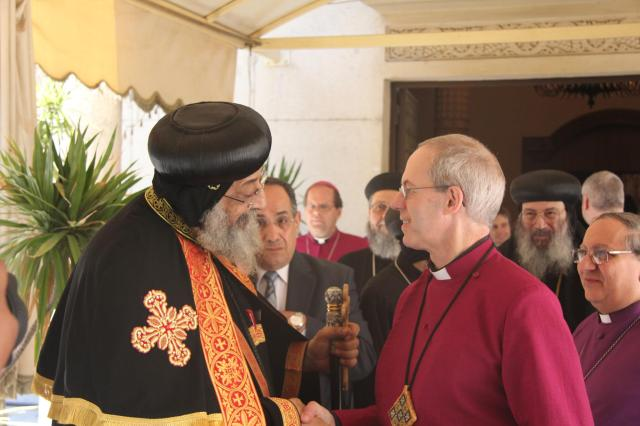 Justin Welby, Archbishop of Canterbury, touring Egypt this week, greeted the Coptic Pope Tawadros II on June 24. (Lambeth Palace)