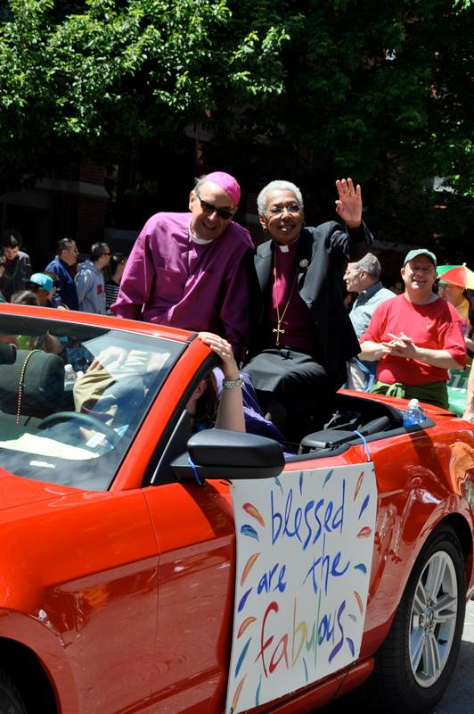 Boston Pride earlier this month: Tom Shaw, SSJE, Bishop of Massachusetts, and Barbara Harris, retired suffragan of the diocese and the first woman bishop in Anglican history. Let the word go forth from this time and place: fabulous rides a red convertible. (Facebook)