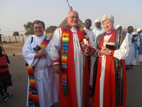We've just obtained this photograph, taken a year and a half ago, of Mauricio Andrade, the Primate of Brazil, and Catherine M. Waynick, Bishop of Indianapolis, at Bor Cathedral in South Sudan with Deacon Andrew Klatte. We show you this because today is kind of Africa Day, with Bishop Ferguson's commemoration in the nation of Liberia and prayers for the diocese of Port Sudan, and one thing more: we really are a worldwide Church, not just as Anglicans but as members of the One, Holy, Catholic and Apostolic. We may sit in our little cubbyholes, dens, chapels and offices, but we're connected to the global and universal God. (Diocese of Indianapolis)
