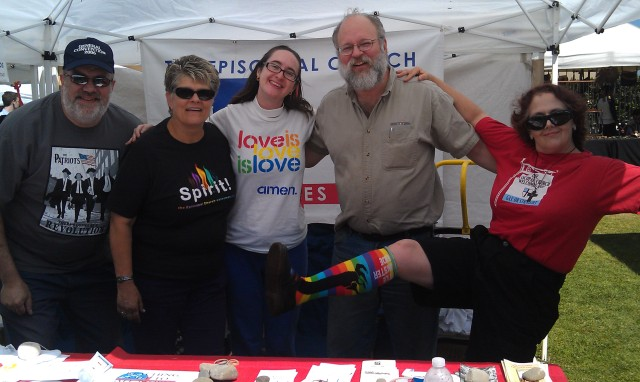 """Melissa Campbell-Langdell, a priest at All Santos, Oxnard, California, sent us this picture with the following note: """"We had our first Episcopal Church booth at Ventura Co. Pride in CA this year and many churches were present or represented across Ventura, LA and Santa Barbara Counties. A bit of goofy fun and majorly sharing God's love to the hurting.."""" Pride Day is supposed to be fun, so there's plenty of room to show off your rainbow socks."""