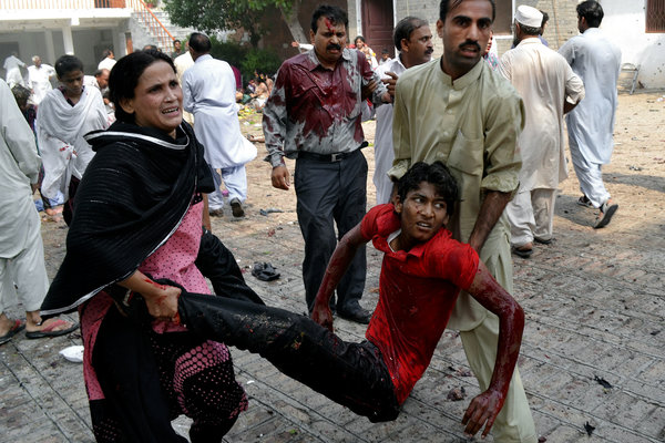 The scene outside All Saints', Peshawar, Pakistan 22 September, after a suicide attack left at least 78 dead. When we think of saints today, let's remember them, and all those persecuted by violence for their Christian faith. (Mohammad Sajjad/Associated Press)