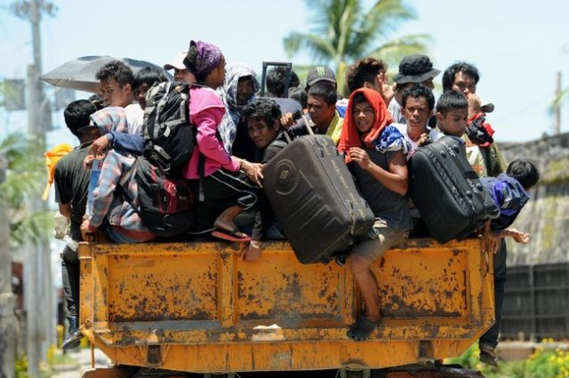 Villagers fleeing the latest upsurge in fighting on Mindinao, the Philippines, where for decades Muslim rebels have been trying to establish their own independent country. (Ted Aljibe/AFP-Getty)