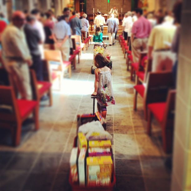 A procession of little red wagons filled with boxes of breakfast cereal for the hungry were part of the offertory recently at Church of the Redeemer, Hyde Park, in the Diocese of Southern Ohio. (parish website)