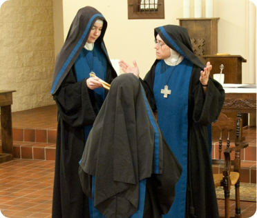 """A sister makes her vows with the Order of Julian of Norwich, 2013. Committed to prayer, intercession, and conversion of life, members of OJN wish to become living extensions of St Julian's """"Revelation of Divine Love"""" in the world, making their own her confidence and delight in God and her wholehearted self-gift in a life dedicated to him alone. Their vocation is a response to the need of the Church and the world for a silent place of intercession and emptiness before the Divine Majesty, a life of witness to the reality of the union of all Christians in the body of Christ, and to the direct claim of love that God has on us."""