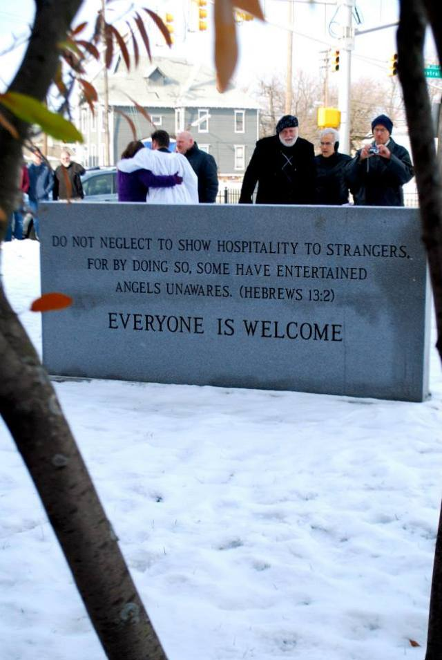The back of the new sign at All Saints', Indy, reminds parishioners of their job. (via Facebook)