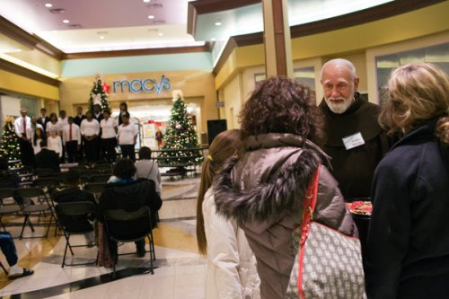 Franciscan monks have established a holiday ministry of presence at an empty storefront in a shopping mall in suburban Cincinnati, Ohio, offering free coffee and a listening ear. Some shoppers are responding. (Maddie McGarvey/The New York Times)