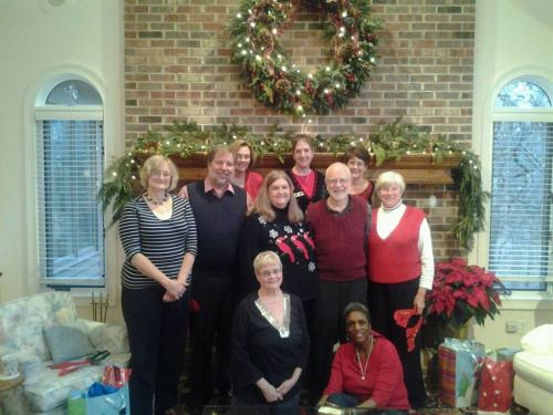 Staff of the Diocese of Indianapolis, at a Christmas party a few days ago at Bishop Cate's home. That's her in the red vest on the right, holding what might be a stray pair of reindeer antlers. (Diocesan Facebook group)