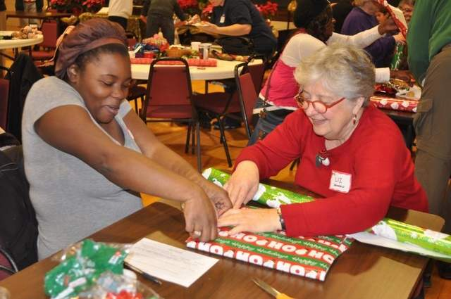 Lafayette, Indiana Urban Ministry, a coalition of churches, held its annual Jubilee Christmas event last Saturday at several locations, including Central Presbyterian, above, and my home parish. All year long, church members buy Christmas presents, toys, clothes, food and other items. Then about 10 days before the holy day, they bring in parents to shop the church's free store for their kids and enjoy refreshments. The parishioners get as much of a kick out of this as the families do; after all, who doesn't need an extra pair of hands sometimes to make wrapping paper behave? This year about 600 families and 1700 children benefited. (Eric Schlene/Journal and Courier)