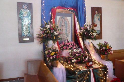 Our Lady of Guadalupe shrine last year at Iglesia Cristo Rey, an Episcopal church in Watsonville, California. The Virgin is said to have appeared before an Aztec peasant near México City in 1531, resulting in many miracles and the conversion of millions. (The Rev. Michael Dresbach)