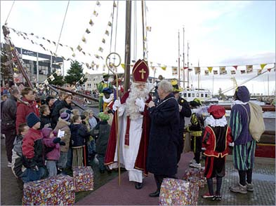St. Nicholas arriving in the Netherlands by boat from Spain, 2006. This is an annually televised event, distinctively Dutch; it's Sinterklaas who brings gifts for children on December 6, not the American Santa Claus on Christmas Eve.