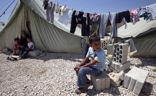 Syrian refugees at a camp near Marj, Lebanon, back in May. (Hussein Malla/Associated Press)