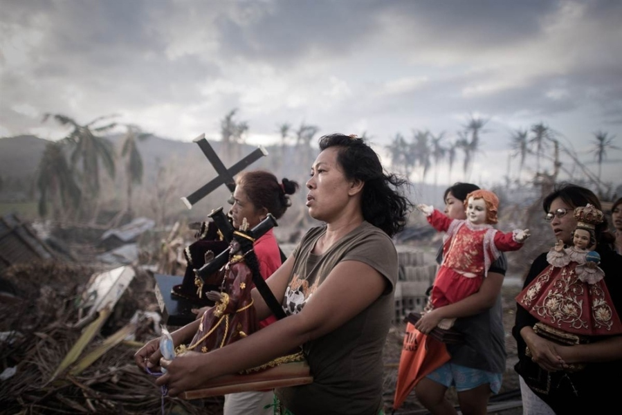 A religious procession in Tolosa, Leyte, the Philippines, after Typhoon Yolanda. If this isn't an act of faith, I don't know what is. (Philippe Lopez/Agence France-Presse/Getty)