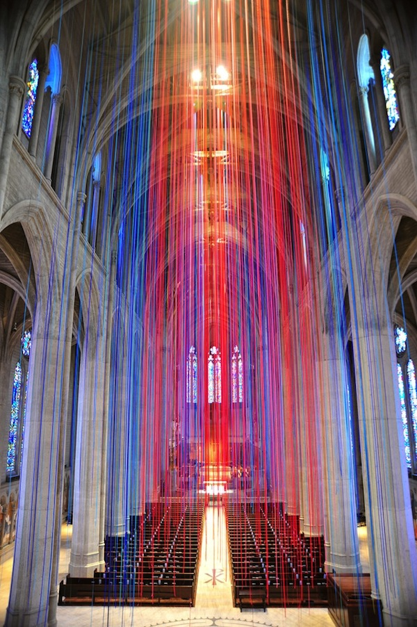 """""""Graced with Light"""" is an installation of 20 miles of satin ribbon colored like stained glass, now on view at Grace Cathedral, San Francisco, through mid-February. It includes music, lights and video, so its appearance changes with the time and occasion. Anne Patterson designed it; it took 8 days to install. (mymodernmet.com)"""