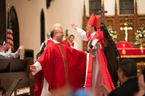 This is a busy time for ordinations in the U.S. Church; last Saturday the Diocese of Los Angeles set aside 12 new priests, while at St. Alban's, Washington, D.C., Bishop Mariann Budde laid hands on Juan Pastor Reyes, an occasion so joyous they were dancing in the aisles. (John Thorne)