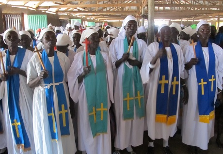 Women priests of the Diocese of Bor in happier times, before some of them were gunned down in the Cathedral last month along with other women and children seeking refuge from the violence. Today is a Churchwide Day of Prayer for South Sudan; see video below. (Jesse Zink)