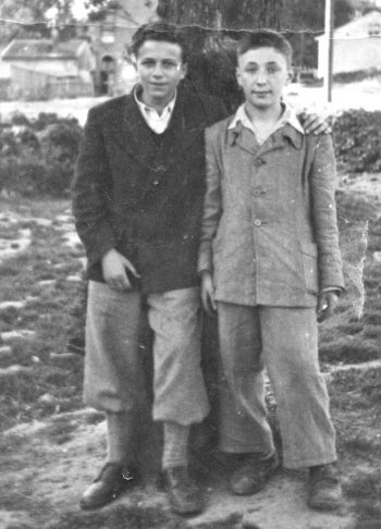 Irving Milchberg, left, and a friend were among the Jewish orphan cigarette peddlers on the streets of Warsaw, Poland during World War II, dodging Nazis and trying to stay alive any way they could. Mr. Milchberg died last week, prompting a retelling of his amazing story of gun smuggling, danger and survival during and after the Warsaw Ghetto Uprising. We include a link to his obituary immediately below.
