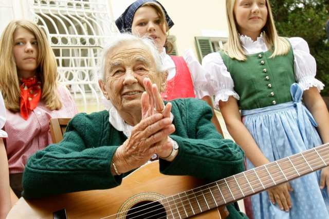 """Maria Franziska von Trapp, the last of the Trapp Family Singers, has died; she was the daughter of Captain Georg and his first wife, Agathe, before Sr. Maria joined the family as governess and eventually became her stepmother. In the Broadway musical and film, """"The Sound of Music,"""" daughter Maria's name was changed to Louisa to prevent confusion. Besides their musical career, she and her stepmother served as lay Catholic missionaries for years in Papua New Guinea. Above, visiting her old home in Salzburg, Austria in 2008. (Leonhard Foeger/Reuters)"""