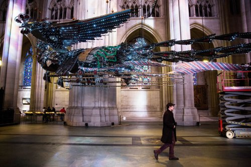 Xu Bing: Sculpture of a phoenix, made of salvaged construction materials from China, draped with lights and installed at the Cathedral of St. John the Divine in New York, with a formal opening on March 1. In Christian thought, the mythical phoenix is a resurrection symbol. Click to enlarge. (Andrew Burton/Getty Images)