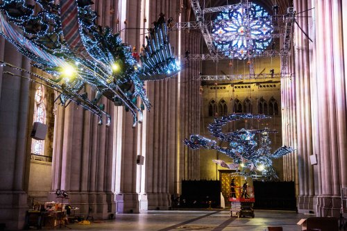 Both of Xu Bing's phoenixes at the installation in St. John the Divine. The artist first planned them for the atrium of a sparkling new building in Beijing's World Financial Center, but when he went to the construction site he was appalled by the low-tech building tools and the migrant workers' poor working conditions. The birds' bodies are made of carefully assembled shovels, hard hats and similar materials. China was hosting the Olympics, the developers wanted his sculptures prettied up, but he declined and the buillders rejected them. Now they're living at the cathedral for the next year. (Andrew Burton/Getty Images)