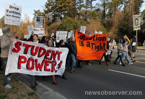"Students at the Moral March in Raleigh: ""Drop tuition, not bombs."""