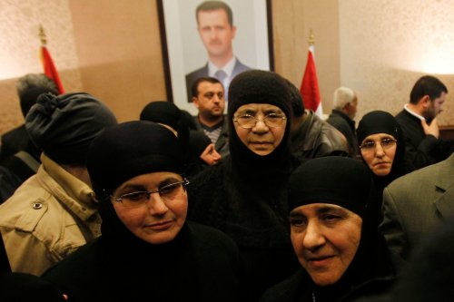 Thirteen Orthodox nuns in Syria have been freed unharmed after three months, amid conflicting reports about whether rebels held them in captivity or protected them in the ongoing civil war. (Khaled al-Hariri/Reuters)