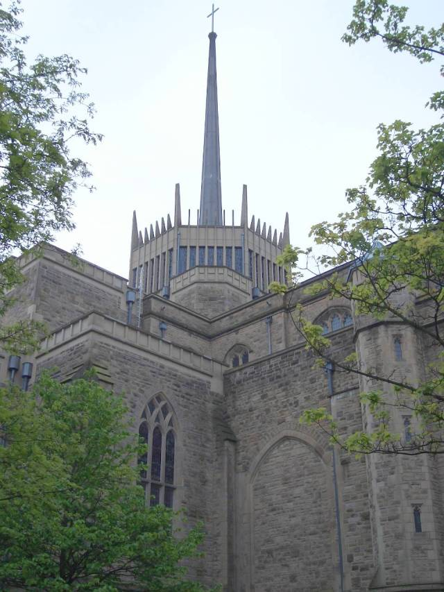 The famous aluminum spire of Blackburn Cathedral of St. Mary the Virgin with St. Paul. At night it becomes a lantern gallery of many colors through the modernistic stained glass. (Wikipedia)
