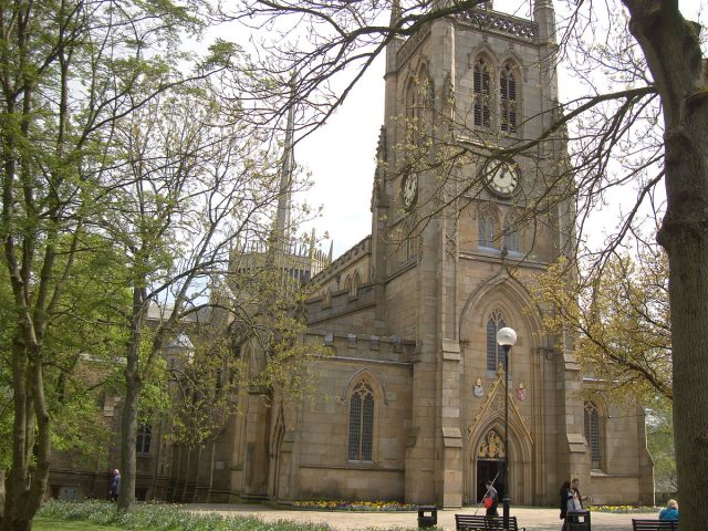 Yesterday we prayed for the Diocese of Blackburn, England in the Anglican Cycle of Prayer, and showed a photo of the cathedral's famous aluminum spire and lantern tower, in the background above. Here's the rest of the building, which is up to two centuries older. (John Armagh/Wikipedia)